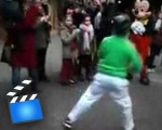 Mickey Mouse accepts breakdancing challenge from a kid.